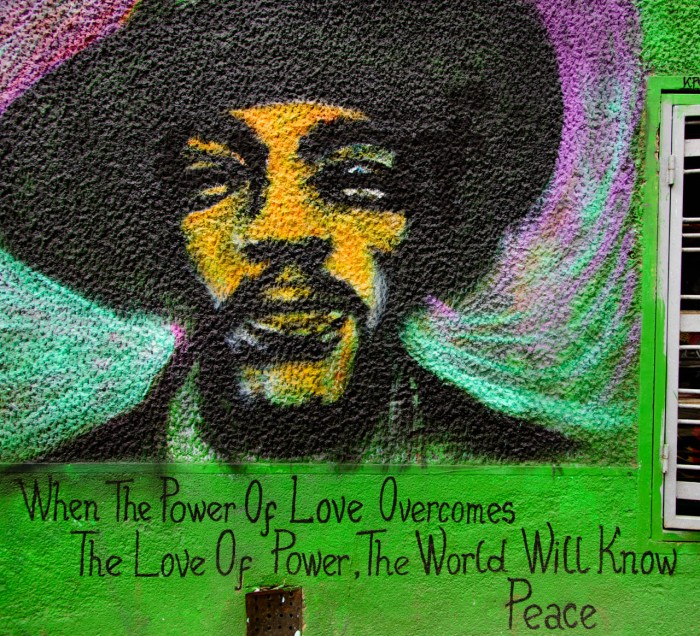 "The quote is from Jimi Hendrix though it may have been influenced by William Galdstone who said, ""We look forward to the time when the Power of Love will replace the Love of Power. Then will our world know the blessings of peace."" and  Sri Chinmoy Ghose who said, ""When the power of love overcomes the love of power, then there will be true peace."""