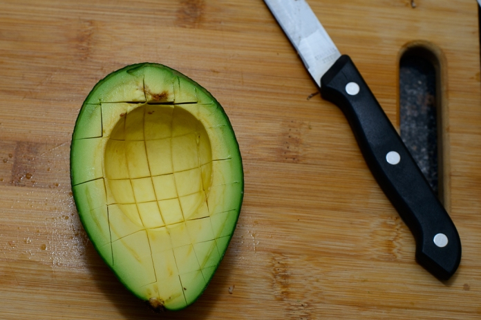 Cut a grid pattern in the avocado and scoop it out